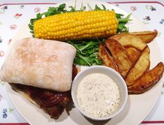 #thefoodarchivist  His; sausage ciabatta with caramelised red onions and mustard mayo spicy potato wedges rocket and corn on the cob  Get a free Cuisinart CookWare Set