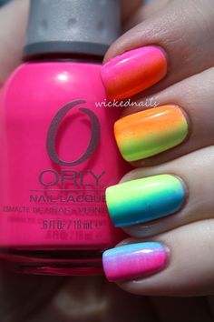 Another style of gradient nail art design in vertical position with multi colored polishes.
