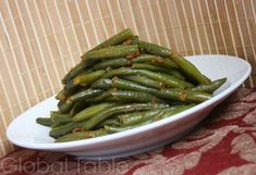 Serves 4 Algerian green beans, called Loubia, are a nice side dish to almost any meal. Make them ahead and reheat in the oven at the last minute. Ingredients: 1 lb fresh green beans 3 Tbsp peanut o...