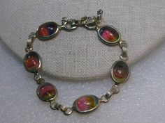 "Vintage Gold Tone Sarah Coventry Rainbow Glass Bracelet, 7.5"", safety chain #SarahCoventry #bezelsetbraceletscarabstyle"