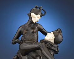 The beloved figures of the clown Pierrot and his paramour, Pierrette, are the subjects of this charming figure by the renowned Bruno Zach. ~ M.S. Rau Antiques