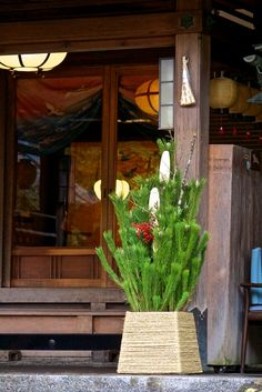 This kadomatsu (門松) is at the entrance of the Kikusuiro Hotel (菊水楼) in Nara. It dates back to the late 19th century and is an old style Japanese inn.