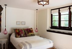 Love those hanging lamps on either side of the bed.