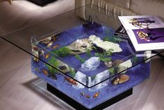 I've always liked the idea of having a fish tank as a decor piece, but other than a tank in place of a wall I could never think of anything else to do. This is pretty cool