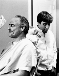 Marlon Brando and Al Pacino during filming of The Godfather. Two of the greatest actors of all time caught making one of the greatest movies of all time!
