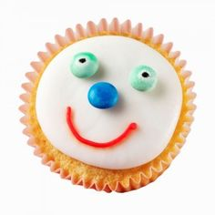 A cupcake with a happy face made out of icing