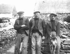 Three Inis Oirr men, dressed almost identically.