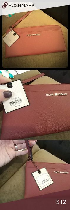 Dana Buchman Clutch Wallet Brand new, never been used!!  Oxblood is the color.  It's a burnt, rusty, mauve-ish color!!  Very nice!!!!  Zipper and Dana Buchman lettering are silver. Inside is a beautiful, shimmery champagne color. Plenty of room and pockets.9.5 x 4.5 in. Thanks!! Dana Buchman Bags