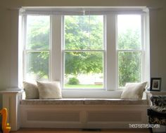 Square Bay Seat Window Cushioned And Either With Open Shelving Or Storage