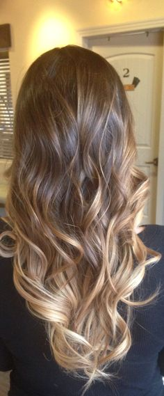 A combination of balayage and ombre in hair.