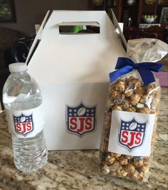 Custom football themed favors including popcorn, chips, pretzels, and a bottle of water branded with the Bar Mitzvah logo. | MitzvahMarket.com