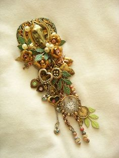 A long bijangly brooch made from charms and vintage tchochkalas I'd saved....one of my fave style theme brooches.   Made by B'sue