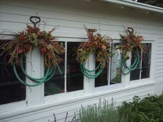 Garden Potting Shed Wreaths! laughed at this :) recyle dead hoses!