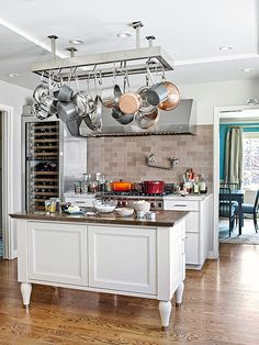 Kitchen Maxwell says: A commercial-style pot rack is a win-win-win. It saves space, makes your gear accessible, and looks restaurant chic. Smart Kitchen, New Kitchen, Kitchen Dining, Kitchen Decor, Kitchen Cabinets, Kitchen Pans, Kitchen Time, Kitchen Layout, Kitchen Interior