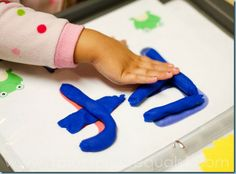 Three-ring binder, alphabet cards in plastic sleeves (or laminated), and play-doh, great Preschool Creation Station idea!!