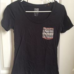 Black Short Sleeve Shirt with tribal pocket Black t shirt with tribal pocket. Good condition. No trades please. We do bundles! Nollie Tops Tees - Short Sleeve