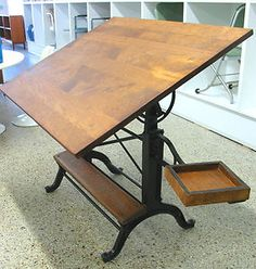 vintage drafting table. We have one of these I bought for my boys. someone had put laminate over the wood. Going to get it back to a beautiful wood top. It would make a gorgeous dining room table as well!!