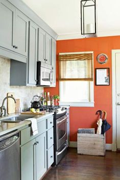 Love the play of cool blue cabinets against warm orange walls! Kitchen On A Budget, Kitchen Redo, New Kitchen, Kitchen Ideas, Kitchen Makeovers, Kitchen Small, Kitchen Paint, Kitchen Updates, Narrow Kitchen