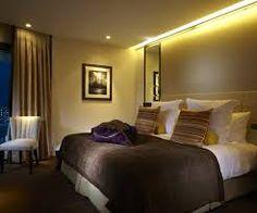 hotels resorts interesting battersea hotel verta elegant design hotel bedroom brown length curtains hotel room white puffy pillow brown b