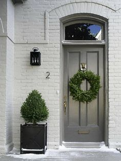 Painted brick with grey door .. House of dreams at Christmas time