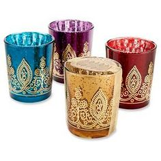 """Create the right kind of atmosphere at your jewel tone wedding or Indian bridal shower with these Indian Jewel Henna Votives, available in four jewel tone colors. The mercury glass of these votive holder favors is decorated with a gold henna print to add to the ambience. <br><br>Jewel tone colored mercury glass (sapphire, amethyst, ruby, citrine) with gold metallic henna imprint<br>Comes packaged with gold organza ribbon and kraft tag<br>Measures 2.5"""" h x 2"""" ..."""