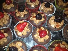 my P.B cupcakes  chocolate cupcakes stuffed with jelly and topped with peanut butter butter cream frosting with fresh fruit
