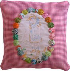 love the yo-yos! (could use one of the motifs in the Sally Dick and Jane fabric surround w/yo yo's.-L)
