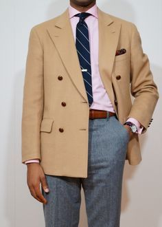 Tan sport coat, white shirt with pink dress stripes, navy tie with white stripes