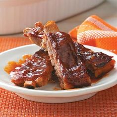 Barbecued Sticky Ribs   Ingredients: garlic powder, salt, pepper, pork spareribs  SAUCE: condensed tomato soup, onion, water, corn syrup, ketchup, cider vinegar, Worcestershire sauce, chili powder, hot pepper sauce, Cinnamon