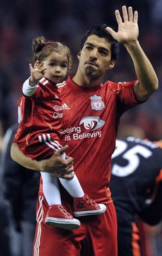 Luis Suarez and his daughter. Seriously adorbs.