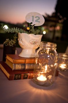 Love the centerpiece with the ball jars, books and the plant.