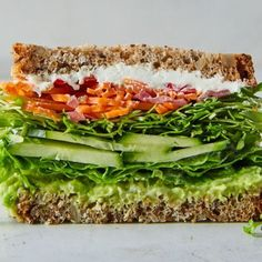 California Veggie Sandwich From Bon Appétit. We like sandwiches that send juices running down to our elbows, which is why we insist on dressing the lettuce. If you want to use store-bought giardiniera, skip the first step. Veggie Recipes, Whole Food Recipes, Cooking Recipes, Vegetarian Sandwich Recipes, Healthy Sandwiches, Vegetarian Dinners, Lunch Recipes, Panini Sandwiches, Cucumber Sandwiches
