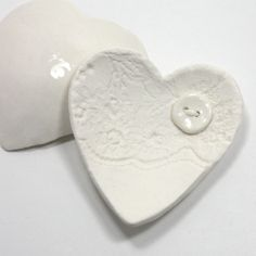 From Vanilla Kiln on Etsy:  Lacy heart trinket dish, white ceramic porcelain, wedding favour, jewellery, button detail