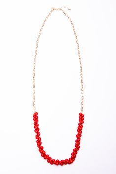 Cute alternative to bubble or bib necklaces.  Love both the red (shown) and they have a mint version too.  Would be super cute with a t-shirt and jeans.  It's just enough...!