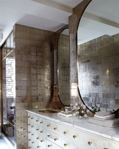 Cameron Diaz's Master Bathroom: The master bath is sheathed in glass tiles by Ann Sacks, the parchment-covered vanity and mirrors are custom made.