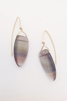 These lovely earrings by Lauren Collignon for Flaming Lotus Jewelry feature two semi-transparent fluorite shields on gold filled ear wires.