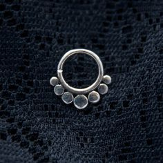 Beautiful dotted septum ring for pierced nose made of pure 925 sterling silver.  Diameter: 10mm Gauge: 18G (1mm)  See more styles in our fake septum section here: https://www.etsy.com/ie/shop/ekekocrafts?ref=hdr_shop_menu§ion_id=17999366  If you are looking for septum rings for pierced nose check this link: https://www.etsy.com/ie/shop/ekekocrafts?ref=hdr_shop_menu§ion_id=17999368  These are also available for wholesale. Pl...