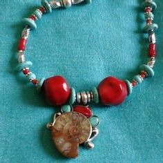 Original Thai sterling silver:fossil, coral,turquoises.  The necklace has the same colour scheme. Rich texture. Handmade OOAK piece.