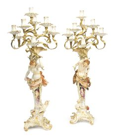 A large pair of rare KPM ormolu-mounted figural eight-light candelabra circa 1890 each modelled in the Neo-Rococo style as a half-length figure of hunched Pan or Syrinx supporting a shell issuing ormolu branches fitted with eight candleholders, all on a pedestal surmounted with a putto above the high scroll-molded base,