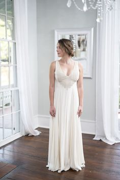 Mara Hoffman - Diana Beaded Gown - <p>Simple yet chic, this ivory-colored silk gown features a well-contoured bodice with low v-neck and plunging v at the back, as well as a fully lined, beautifully draped skirt. Expertly beaded feather embellishments complete this subtly bohemian look. Love it!</p>