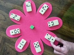 Practicing number combinations with dice and dominoes. On the Keep 'Em Buzzy Blog Hop.