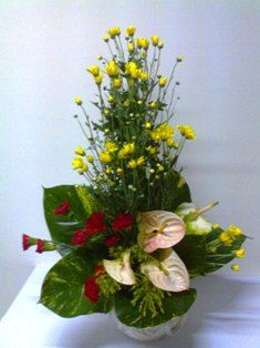 Arrangement with ANTHURIUMS & CHRYSANTHEMUMS
