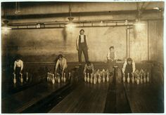 Pinboys working at the Subway Bowling Alley located at 65 South St., Brooklyn, New York. It is noted that three smaller boys were kept out of the photo by the boss. This photo was taken at 1:00 A.M. in April 1910.