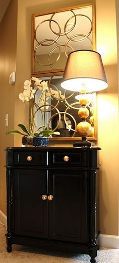 console table~~love how the mirror duplicates the shape of the lamp