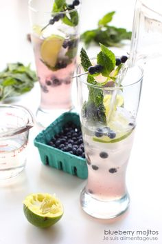 Wild Blueberry Mojitos: Guest Post by Je suis alimentageuse by Cravings of a Lunatic Party Drinks, Cocktail Drinks, Fun Drinks, Cocktail Recipes, Alcoholic Drinks, Beverages, Drink Recipes, Refreshing Drinks, Fruit Recipes