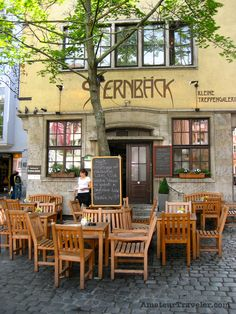 Sidewalk Cafe - Wuerzburg, Germany by Chris Christensen