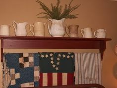 Quilts for a shelf, love the decorating idea