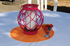 Outdoor bridal shower - simple center piece idea. Lantern on colorful place mat and martini glass filled with candy