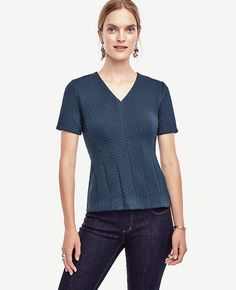 """Expertly seamed and structured, our jacquard top fits like a dream. V-neck. Short sleeves. Hidden back zipper with hook-and-eye closure. 24 1/4"""" long."""