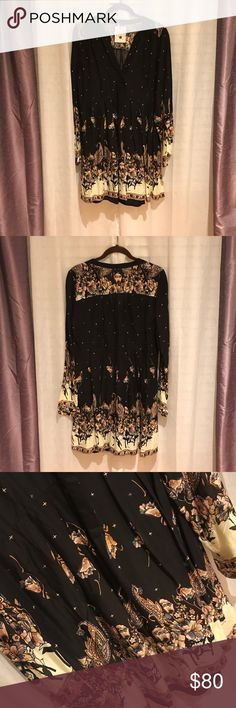 Free People Sierra Valley Printed Black Dress Free People Sierra Valley Printed Black Dress. Brand New. Never worn. Hard to find. Very Popular dress. Was seen on the Originals TV show. Includes a black slip underneath. Beautiful dress. Perfect for the Fall weather! Authentic. Free People Dresses Long Sleeve
